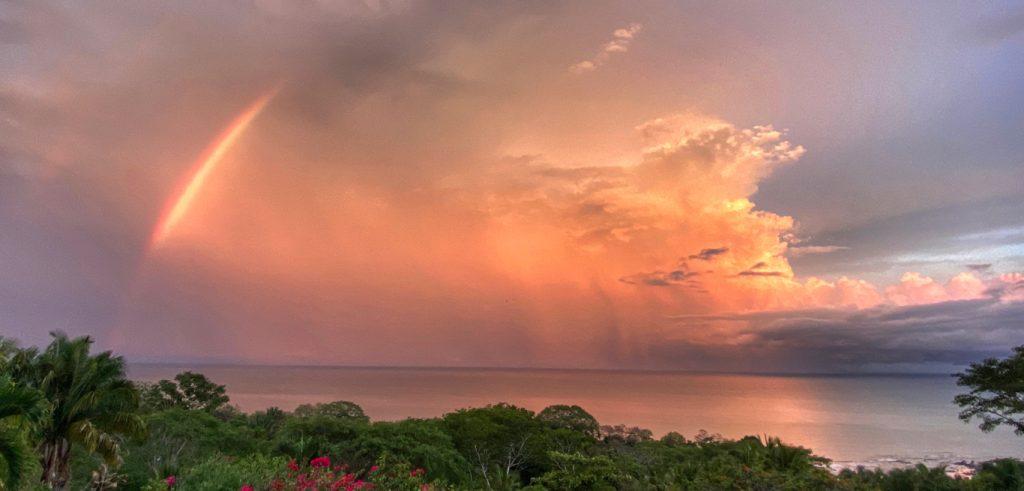 Orange and purple Sky with Rainbow over Cedros beach