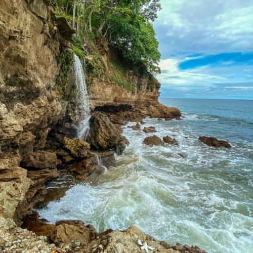 El Chorro waterfall emptying into the ocean