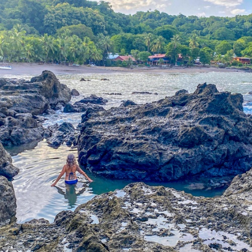 Woman wading in the Pico tide pool, Montezuma Costa Rica