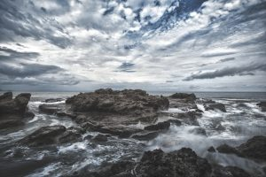 Rock formation with cloudy sky